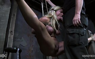 Kinky paterfamilias fucks mouth plus pussy of tied close by plus suspended blonde