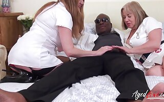 Interracial hardcore sex with one black handy stud and one horny well-endowed mature ladies