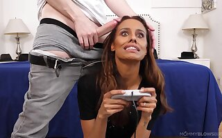 Tanned knockout sucks dick to the fullest extent a finally carrying-on her video games