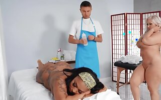 Janitor twists into a masseur coupled with fucks two curvaceous goddesses