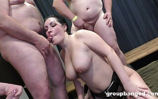 Chunky boobed bimbo shares her nookie nest with a few studs