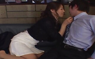 Smooth fucking on the leather sofa upon an adorable Japanese girl