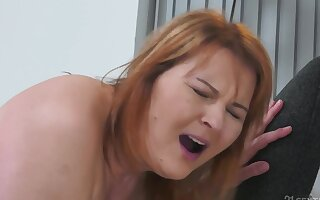 Mature redhead and her young sweetheart begin day with amazing sex