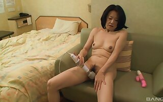 Asian mature toys herself in a hotel room