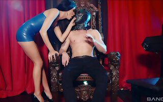 Brunette dominates her male slave and plays with his dick