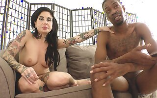 Tattooed pornstar Joanna Angel naked in the backstage interview