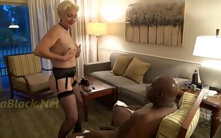 Marketable GILF seduces big pitch-black guy