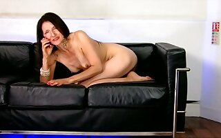 She likes adjacent to wear heels and she loves talking on the phone while being naked