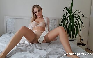 Alone emotional and magnificent hottie in beige stockings Siya masturbates pussy