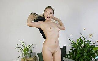 Amateur slut Lira Kissy loves undressing and flashing with the brush pussy