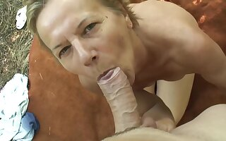 Hungarian mature is sucking a rock hard dick in the forest and getting drenching inside her pussy