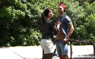 Hyper sexual aged woman seduces one pretty boy in the park