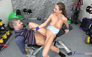 Sweet Tina Kay drops her bra and panties to thing embrace in advance gym